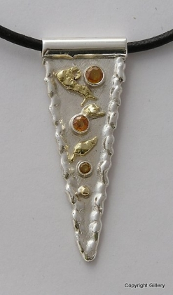 Silver & 18ct Gold pendant with yellow Sapphires