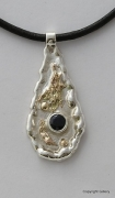 Silver & 18ct Gold pendant with blue Sapphire
